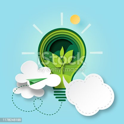 Paper cut of green ecology and environment conservation concept with seedling in light bulb and cloud bubble speech.Vector illustration.