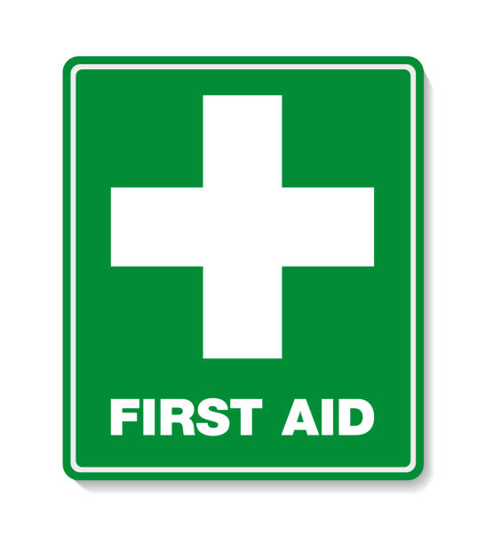 green first aid sign with cross symbol - first aid stock illustrations