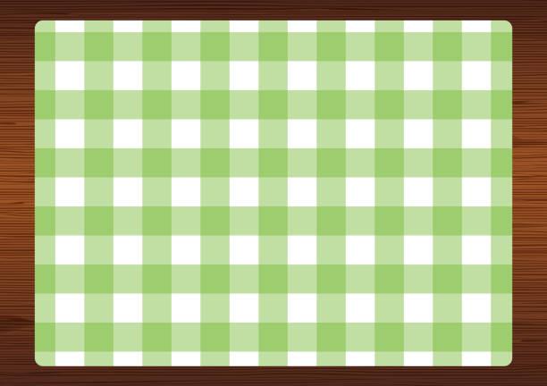木製のテーブルの表面に緑色のギンガム マット - ランチョンマット点のイラスト素材/クリップアート素材/マンガ素材/アイコン素材