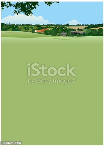 A typically English summer landscape with farm, woodland and fields, with a large area for copy.
