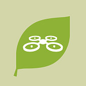 Green leaf icon with  a quadcopter drone