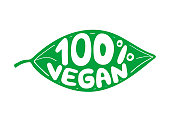 Green leaf with rubber stamp effect and hand lettering of the text 100 percent vegan.