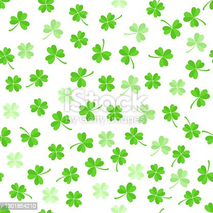 istock Green leaves clover seamless pattern on white background. 1301854210