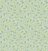 Seamless pattern with soft green leaves and yelloe berries on light green background. The style is romantic and classic. The file uses global colors (CMYK).