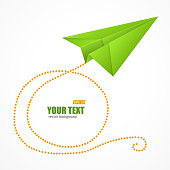 Green paper plane on blue sky and text box