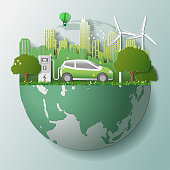 Green renewable energy ecology technology power saving environmentally friendly concepts, electric car at charging station beautiful park city background on globe