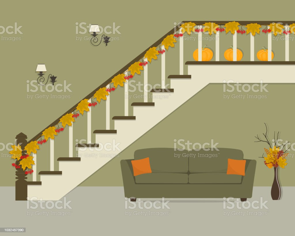 Green Sofa With Orange Pillows Located Under The Stairs Decorated