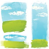 Green grunge landscapes on blue sky background with white clouds.