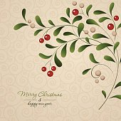 Green sprig with red berries isolated on vintage background