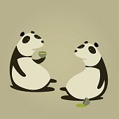 Two Pandas drinking Green Tea