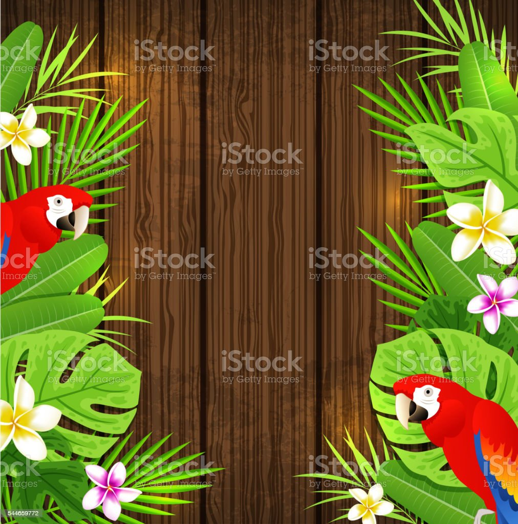 Green tropical leaves, flowers and red parrots on a wooden background.