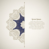 Greeting card in oriental style. Template of greeting card or invitation with ethnic ornament. Oriental pattern. Round lacy pattern. Beautiful Mandala.