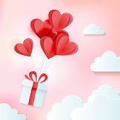 Greeting card of love and Valentine's day with bunch of heart baloons with gift in clouds. Paper cut style. Vector cozy pink illustration.