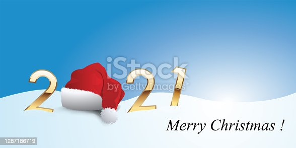 istock 2021 greeting card showing Santa's hat falling on the snow. 1287186719
