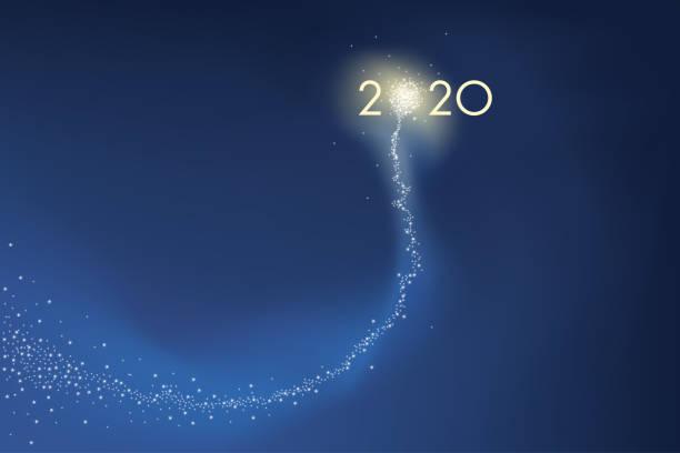 2020 greeting card with a glowing star that shines in space. Carte de vœux présentant l'objectif 2020 sous la forme d'une comète explosant en feu d'artifice, symbole de réussite pour la nouvelle année. new years day stock illustrations