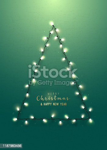 istock Greeting card with christmas tree on green wall. Realistic lighting garlands. Merry Christmas and Happy New Year. Stock Vector illustration. 1187983456