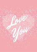 Greeting card with pastel pink glitter heart and text. Shimmer love background.
