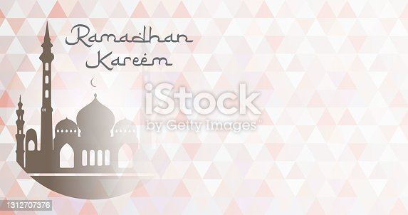 istock Greetings to welcome the blessed month of Ramadan. Ramadan Kareem banner with mosaic background. 1312707376
