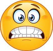Grimacing emoticon showing bared teeth