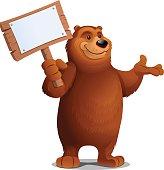 A grizzly bear cartoon holding a sign.