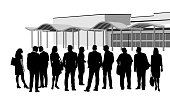 A vector silhouette illustration of a large group of business men and women standing outside of a convention centre.