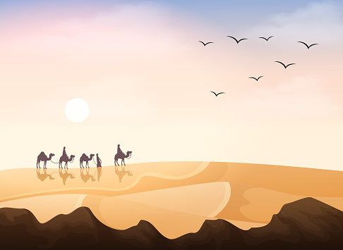 Group of Arab people riding with camels caravan in the desert