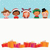 Group of children in costumes and Christmas gifts