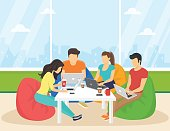 Group of creative people using smartphone, laptop sitting in the