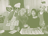 Engraving illustration of a Group of friends baking Christmas cookies