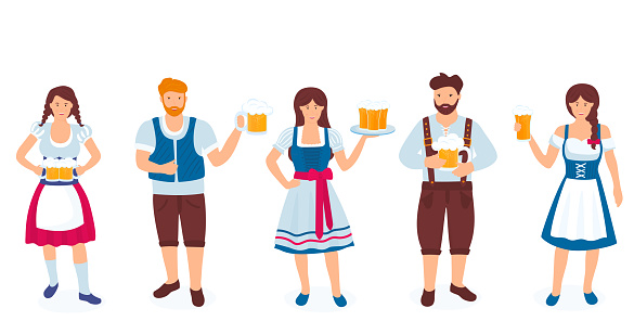 A group of guys and girls in national German costumes are holding glasses of beer. Celebration of Oktoberfest