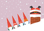 Group of Little Santa looking at Big santa stuck in chimney
