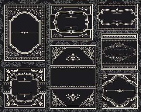 A group of old black ornate vintage frames