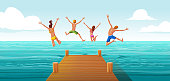 Group of people jumping from wooden pier into the water. Family having fun jumping in the sea water.