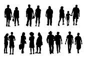 Set of walking people silhouettes