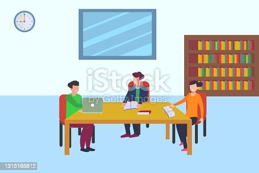 istock Group of teens studying together in the library 1315165812