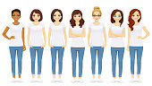 Group of young women standing in white t-shirts isolated
