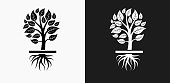 Growing Tree Icon on Black and White Vector Backgrounds. This vector illustration includes two variations of the icon one in black on a light background on the left and another version in white on a dark background positioned on the right. The vector icon is simple yet elegant and can be used in a variety of ways including website or mobile application icon. This royalty free image is 100% vector based and all design elements can be scaled to any size.