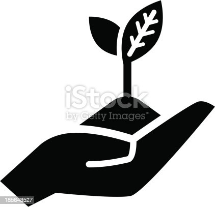 Handful of earth with young plant on open hand