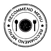 Grunge black recommended menu word with dish, spoon and fork icon rubber seal stamp on white background