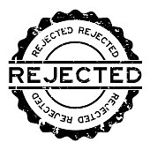 Grunge black rejected word round rubber seal stamp on white background