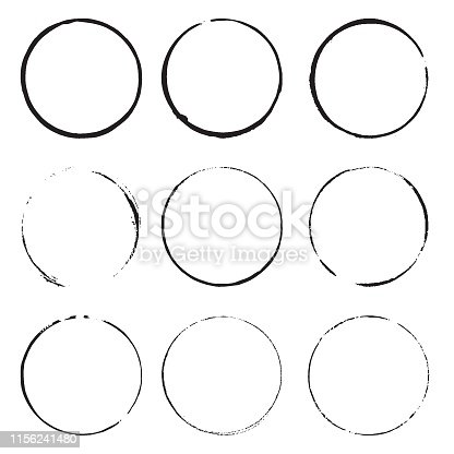 Grunge circles . Black round frames on a white background. Design element ring stains.
