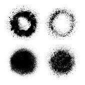 Circle grunge design elements. Crushed charcoal isolated black on white background. Black powder, dust, different shapes. Set of vector texture images. Round shapes.