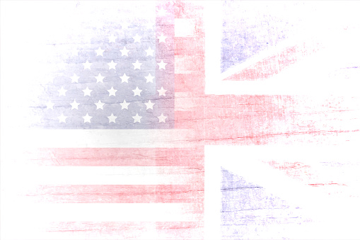 A grunge effect horizontal vector illustration of faded USA(American)  and England  or the Great British flag Union Jack together blending into white backgrounds