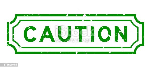 istock Grunge green caution word rubber seal stamp on white background 1311659761
