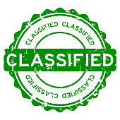 Grunge green classified round rubber stamp on white background