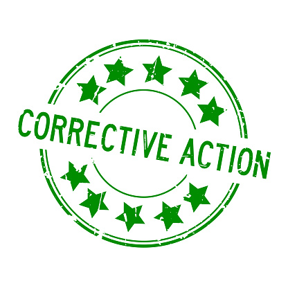 Grunge green corrective action word with star icon round rubber seal stamp on white background