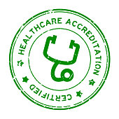 Grunge green healthcare accreditation with stethoscope icon round rubber seal stamp on white background