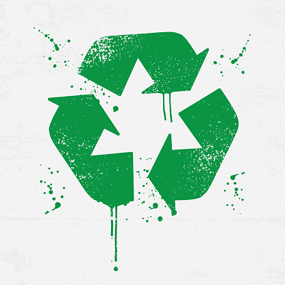 Grunge recycling icon with splatters