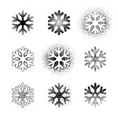 Set of grunge snowflakes. Vector design elements isolated on white background. Set of nine different variations. One color - black.