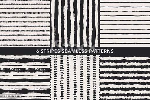 Grunge stripes hand drawn seamless patterns set. Black paint dry brushstroke background, backdrop. Vector ink brush strokes, smears, lines, hatches texture. Monochrome wrapping paper, wallpaper design.